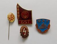 4x východoněmecký odznak GST (Gesellschaft für Sport und Technik)